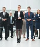Confident business woman standing in front of his business team. Stock Photos