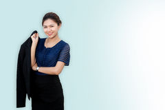 Confident business woman standing and holding her coat royalty free stock photography