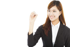 Confident business woman standing and holding a pencil Stock Photos