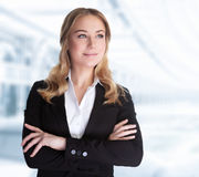 Confident business woman. Standing in the office, CEO of great corporate, successful career, female in the modern work place, professional people lifestyle royalty free stock photos