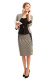 Confident business woman talking on the phone and holding tablet Royalty Free Stock Images