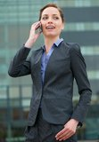 Confident business woman talking on phone. Portrait of a confident business woman talking on phone Royalty Free Stock Photos