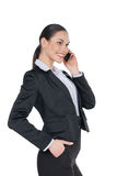 Confident business woman talking by phone. Stock Images