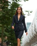 Confident business woman walking outdoors Stock Images