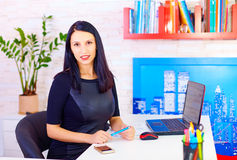 Confident business woman working in office Stock Photo