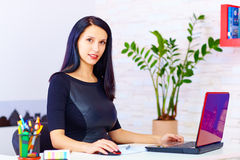 Confident business woman working in office Stock Images