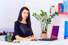 Confident business woman working in office Stock Photography