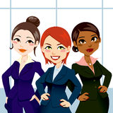 Confident Business Women. Three attractive and confident business women standing with and hands on hips Royalty Free Stock Photo