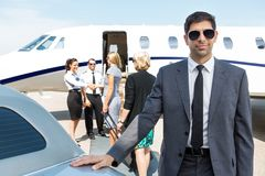 Confident Businessman At Airport Terminal Royalty Free Stock Image