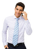 Confident Businessman Answering Smart Phone Stock Photos