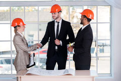 Confident businessman architects shaking hands royalty free stock photography