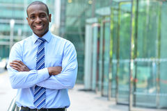 Confident businessman with arms crossed Stock Photos