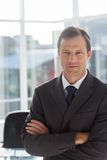 Confident businessman with arms folded Stock Photography