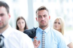 Confident businessman on background of a blurred office. Stock Image