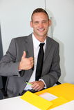 Confident businessman with a beaming friendly smile Stock Photography