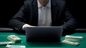 Confident businessman betting all money on online poker game, casino web site stock photography