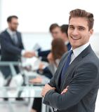 Confident businessman on blurred office background royalty free stock photo