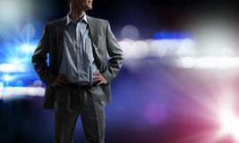 Confident businessman in bokeh lights Royalty Free Stock Photos