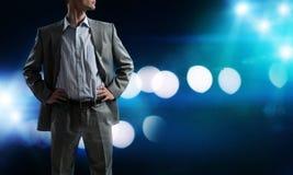 Confident businessman in bokeh lights Stock Image