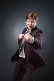 Confident businessman boxing in suit Royalty Free Stock Image