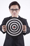 Confident Businessman with Bull's Eye. Asian businessman holding a dartboard with bull's eye Royalty Free Stock Image