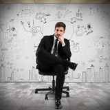 Confident businessman. With a business project background Stock Photo