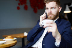 Confident Businessman in Cafe Stock Photography