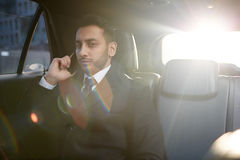 Confident Businessman Calling by Phone from Car Royalty Free Stock Photos