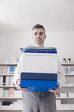Confident businessman carrying boxes Stock Photography