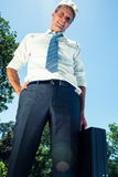 Confident businessman carrying briefcase Stock Image