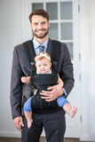 Confident businessman carrying daughter Royalty Free Stock Photo