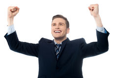 Confident businessman celebrating his success Royalty Free Stock Photos