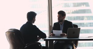 Company employer handshake hire male vacancy candidate at job interview