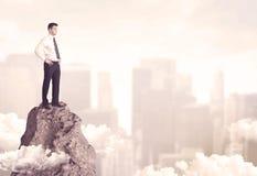 Confident businessman on dangerous cliff Stock Photos