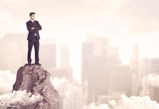 Confident businessman on dangerous cliff Royalty Free Stock Photography