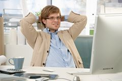 Confident businessman at desk desk Stock Photography