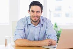 Confident businessman at desk Stock Photos