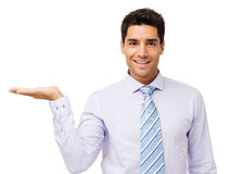 Confident Businessman Displaying Invisible Product Royalty Free Stock Images