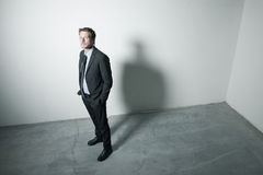 Confident businessman with dramatic lighting Royalty Free Stock Photos