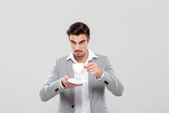 Confident businessman drinking coffee Royalty Free Stock Images