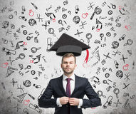 Confident businessman and education icons Stock Photos