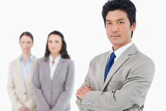 Confident businessman with employees behind him Stock Photography