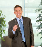 Confident Businessman In Executive Office Royalty Free Stock Photography