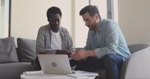 Young african american intern consulting with professional mentor.