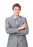 Confident businessman with folded arms Stock Photography