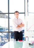 Confident businessman with folded arms Royalty Free Stock Photo