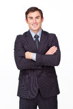 Confident businessman with folded arms smiling Royalty Free Stock Photography