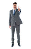 Confident businessman gesturing thumbs up Royalty Free Stock Image