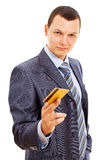 Confident businessman giving plastic card Royalty Free Stock Images