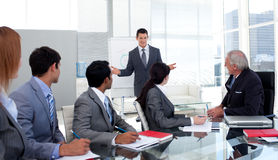 Confident businessman giving a presentation stock image